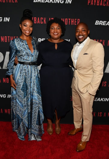 "ATLANTA, GA - APRIL 22: (L-R) Gabrielle Union, Stacey Abrams and Will Packer attend ""Breaking In"" Atlanta Private Screening at Regal Atlantic Station on April 22, 2018 in Atlanta, Georgia. (Photo by Paras Griffin/Getty Images for Universal Studios)"